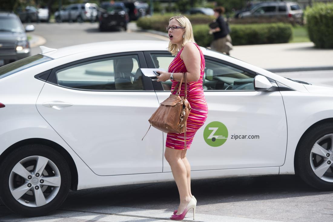 UNITED STATES - SEPTEMBER 18: Rep. Kyrsten Sinema, D-Ariz., catches a ride in a ZipCar at the House steps following a vote on Thursday, Sept. 18, 2014. (Photo By Bill Clark/CQ Roll Call)