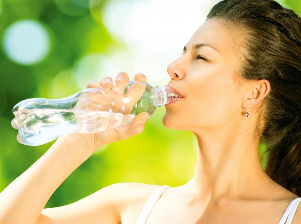 woman-drinking-out-of-bottle-of-water