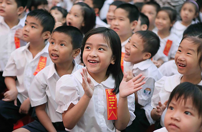 04 Sep 2013, Hanoi, Vietnam --- (130904) -- HANOI, Sept. 4, 2013 (Xinhua) -- Students attend a new semester opening ceremony at Tran Quoc Toan Primary School in Hanoi, capital of Vietnam, Sept. 4, 2013. Over 18 million students of primary and middle schools in Vietnam ushered in a new semester in early September. (Xinhua/VNA) --- Image by © VNA/Xinhua Press/Corbis
