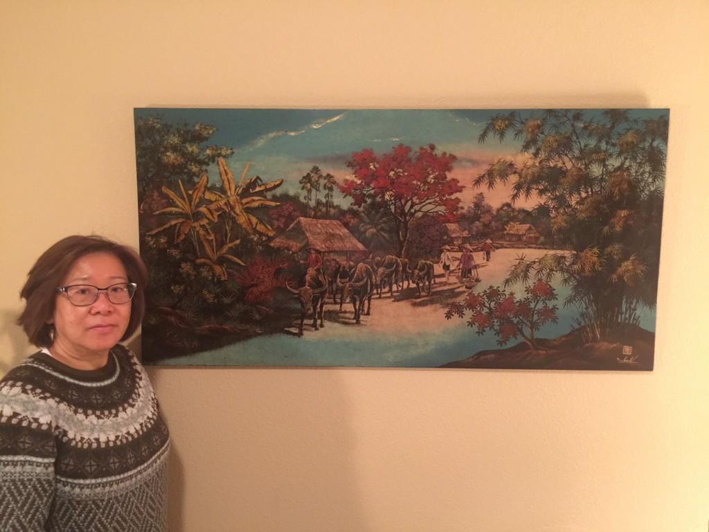 Bai nguoi xa xu cua Do YEn- co Jung Hogan chụp với bức tranh