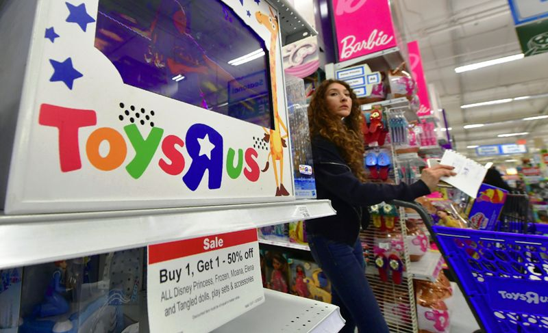 A woman shops at a Toys R Us store in Alhambra, California, on December 19, 2017 amid reports Toys R Us may close up to 200 stores across the US while suffering from weak holiday sales. Toys R US filed for Chapter 11 bankruptcy protection earlier this year and US sales have dropped some 15 percent this holiday season compared with a year ago. / AFP PHOTO / FREDERIC J. BROWN (Photo credit should read FREDERIC J. BROWN/AFP/Getty Images)