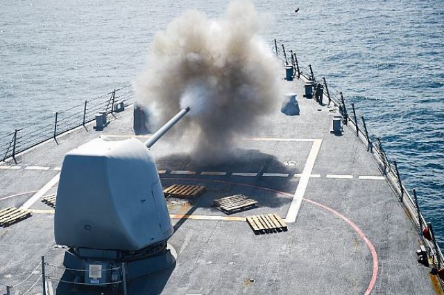 160724-N-YS140-018 SOUTH CHINA SEA (July 24, 2016) The Arleigh Burke-class guided-missile destroyer USS Stethem (DDG 63) fires its Mark 45/5-inch lightweight gun at a surface target during a live-fire exercise as part of Cooperation Afloat Readiness and Training (CARAT) Singapore 2016, July 24. CARAT is a series of annual maritime exercises between the U.S. Navy, U.S. Marine Corps and the armed forces of nine partner nations to include Bangladesh, Brunei, Cambodia, Indonesia, Malaysia, the Philippines, Singapore, Thailand, and Timor-Leste. (U.S. Navy photo by Mass Communication Specialist 1st Class John Pearl/Released)