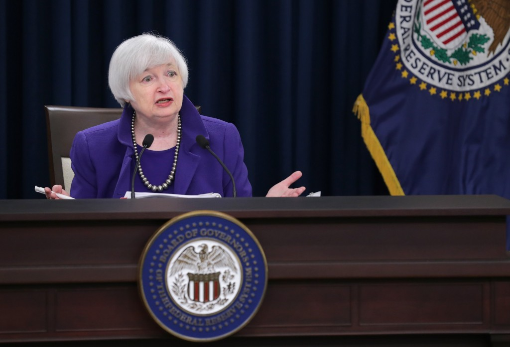 WASHINGTON, DC - DECEMBER 16: Federal Reserve Bank Chair Janet Yellen holds a news conference where she announced that the Fed will raise its benchmark interest rate for the first time since 2008 at the bank's Wilson Conference Center December 16, 2015 in Washington, DC. With unemployment at 5-percent and the economy showing signs of strength, the Fed raised the interest rate a quarter of a percentage point and many experts believe the interest rate on short-term loans could go as high as one percent by the end of 2016. (Photo by Chip Somodevilla/Getty Images)