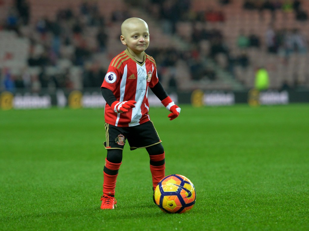 Bradley Lowery, aged five, who is terminally ill with cancer, plays football on the pitch before the Premier League match at the Stadium of Light, Sunderland.