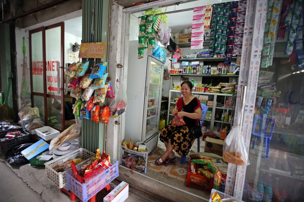 Nguyen Thi Dung, 57, sits opposite her grocery  in Ap Don hamlet, Yen Trung commune, Yen Phong district which is located opposite Samsung Electronics Vietnam Plant, Bac Ninh Province, Vietnam 01 September 2016. Dung currently has 10 rooms rented by Samsung Vietnam workers.
