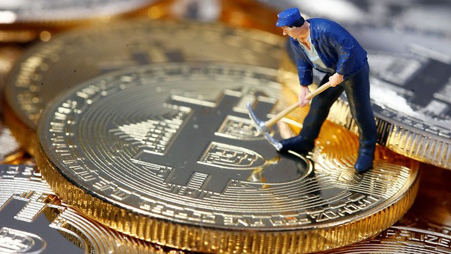 A small toy figure is seen on representations of the Bitcoin virtual currency in this illustration picture, December 26, 2017. REUTERS/Dado Ruvic/Illustration